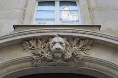 Lion above parisian doorway - stock photo