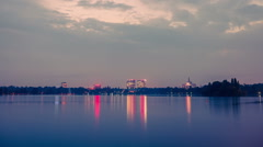 Holy grail sunset timelapse day to night over lake reflecting dusk Stock Footage
