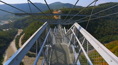 Descend the steps of the bridge Stock Footage