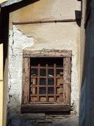 old window with metal grating - stock photo