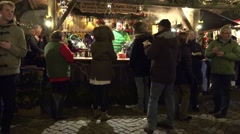 4k Christmas fair with hot drinks at cold windy night Stock Footage