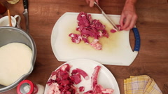 Meat dish - cutting steak slices onto cubes with sharp knife Stock Footage