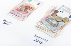 More taxes 2015 Stock Photos