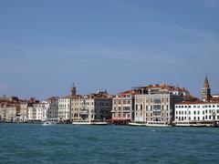 venice - exquisite antique buildings along san marco canal - stock photo