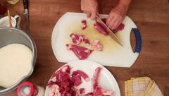 Meat dish - chopping t-bone steak on small chunks Stock Footage