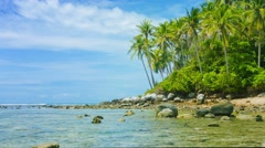 Rocky shallows along a wild tropical beach in thailand, asia Stock Footage
