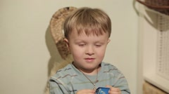 Little boy listening to music, Close-Up Stock Footage