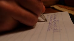 4K Writing a letter at night Stock Footage