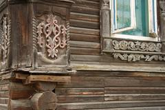 Old wooden house with carved decoration - stock photo