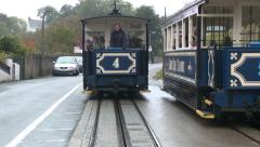 Dramatic shot of two tram cars crossing on the Great Orme Tramway Stock Footage