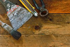Various diy tools on old rustic work bench Stock Photos