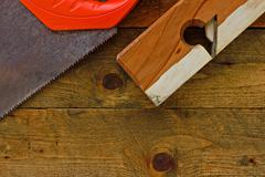 Various old diy tools on rustic wooden work bench Stock Photos