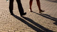 Moving shadows of walking couple and mother with girl. - stock footage