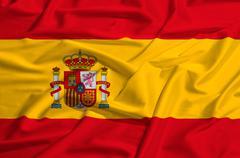 Spain flag on a silk drape waving - stock illustration