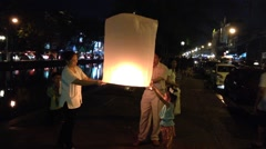 Family releases a lantern at loy krathong (yi Peang) Chiang Mai, Thailand, Asia Stock Footage