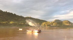 Ferry crossing the Mekong River in Luang Prabang, Laos, Asia Stock Footage