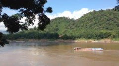 Long-tail boat at the Mekong River in Luang Prabang, Laos, Asia Stock Footage