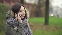 Young woman talking deny on the phone - stock footage