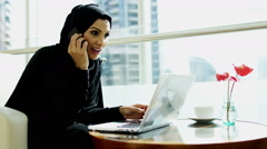 Stock Video Footage of Arabic business female stocks shares commodity laptop computer smart phone