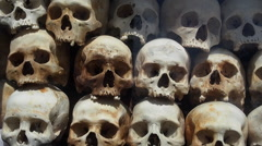Skulls of Victims at the Killing Fields of Choeung Ek, Phnom Penh, Cambodia Stock Footage