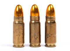 Three ammunition for firearms Stock Photos