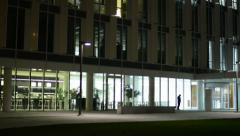 Modern building and people leave the building office -quitting time and interior Stock Footage