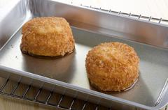 fried trout fishcake in a roasting tray - stock photo