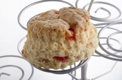 cherry scone on a cake stand - stock photo