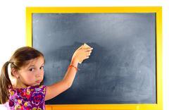 A young schoolgirl erase the blackboard Stock Photos