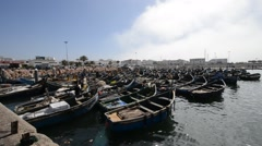 Fishing boats in the harbour of Agadir - stock footage