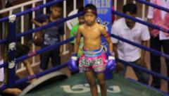 Child Fighter Muay Thai Boxing Match Fight Stadium Ring Blue Corner Slow-motion Stock Footage