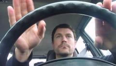 Man Rocking Out While Driving Car Arkistovideo