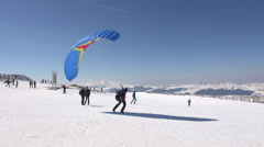 Snow kite on windy day on mountain slope extreme sports in winter season Stock Footage
