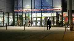 Exterior shopping center night - entrance/exit - christmas lights Stock Footage