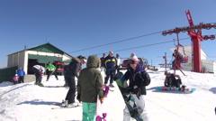 Sky lift, snowboarding, skiers, winter season, mountain, sky resort Stock Footage