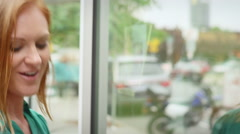 Close up of woman talking to her date while they window shop - stock footage