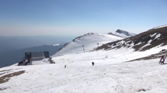 People climbing up, mountain, winter, snow, sunny day, chalet Stock Footage