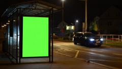 Bus stop - billboard - green screen - night - urban street with cars Stock Footage