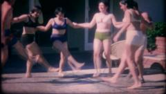 1374 - teenages at the pool do a bikini dance - vintage film home movie - stock footage