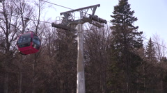 Gondola lift with cable car, pylon and wheels on mountain in winter Stock Footage