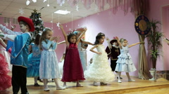 Stock Video Footage of Preschool children in carnival costumes playing the game on stage at Christmass