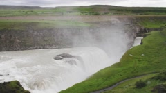 Hvatn river plunging over Gullfoss or Golden Falls Stock Footage