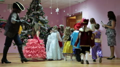 New Year carnival on the kindergarten`s stage with children and teacher Stock Footage