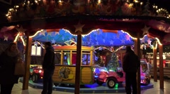 4k Carousel at Christmas fair panning shot Stock Footage
