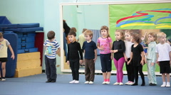 Female trainers with preschool kids on the fitness exercises Stock Footage