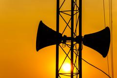 Loudspeaker on pillar and sunset in the evening Stock Photos