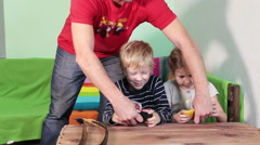 Father wresting smartphones from the children hands when they playing long time Stock Footage