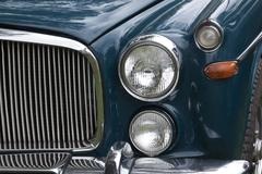 Closeup of chrome grille and lights of restored classic car Stock Photos
