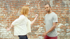 Young couple pose and make faces Stock Footage