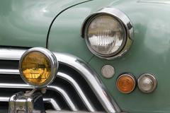 Closeup of grille and lights of restored classic car Stock Photos